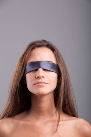 blindfolded: Blindfolded girl waiting misterious and maybe sexy opportunities Stock Photo