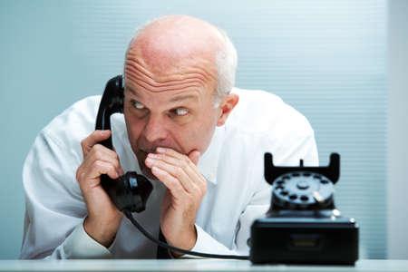 gossip: Businessman blurting by phone  focus on the man