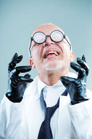 Crazy weird scientist exulting photo