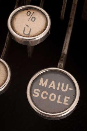 majuscule: close up of caps key on an antique  mechanical italian typewrite Stock Photo