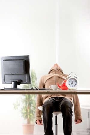 ineffective: young employee sleeping on his chair instead of working