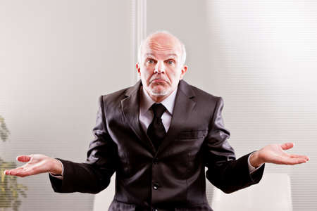feeble: feeble businessman expressing impotence with a typical italian gesture