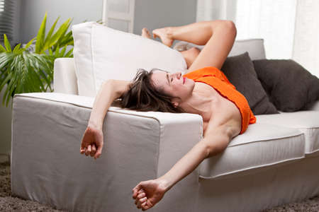 sagacious: long legs girl yawning and stretching on her sofa while she wakes up