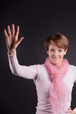 salutation: mature woman with a raised hand