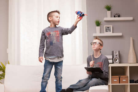 two boys playng as scientists and rocket inventors Stock Photo