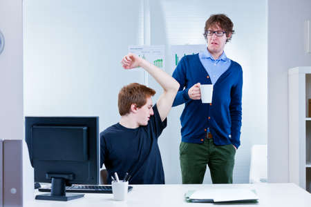 boss disgusted because of body odour coming from employees pit stains and lack of workplace hygiene