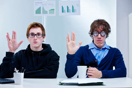 popular science: a couple of nerd office workers showing a very popular science fiction salutation