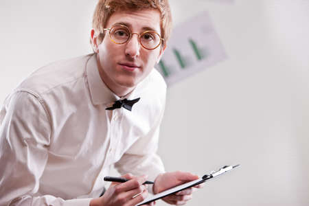 annoying redheaded clerk with glasses and a notepad asking more precision photo