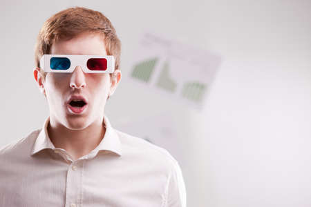 dazzled man with 3d glasses and open mouth