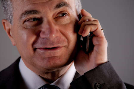 A senior manager using successfully his inseparable smartphone agenda and calendar Stock Photo