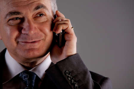 inseparable: A senior manager using successfully his inseparable smartphone agenda and calendar Stock Photo