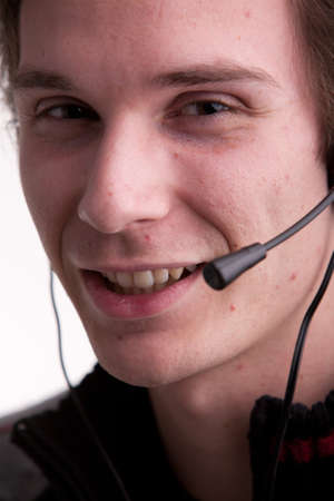 call center young man with a headset photo
