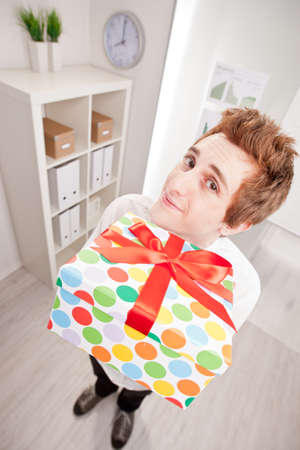 happy clerk with a big gift in wide-angle point of view