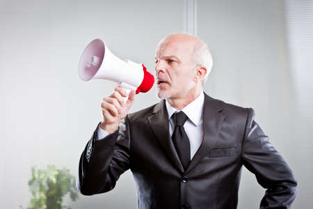 bossy: boss giving orders to his employees in a very bossy way