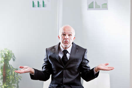 business man showing off empty hands meaning he can't do nothing