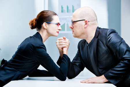 arm wrestling business woman VS business man Stock Photo