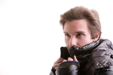 anorak: beautiful young man posing in winter with a warm anorak Stock Photo