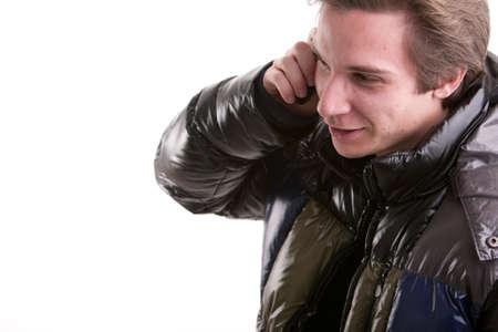 Anorak: Portr�t oaf ein goold aussehender junger Mann telefoniert auf einem beweglichen Telefon Lizenzfreie Bilder