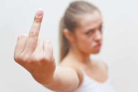 THE middle finger gesture by a young woman photo
