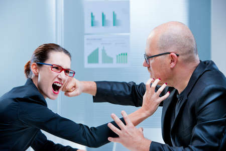 challenging sex: business woman and business man fighting facing each other