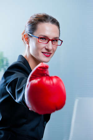 winning business woman: smiling skinny winning business woman with a red box glove
