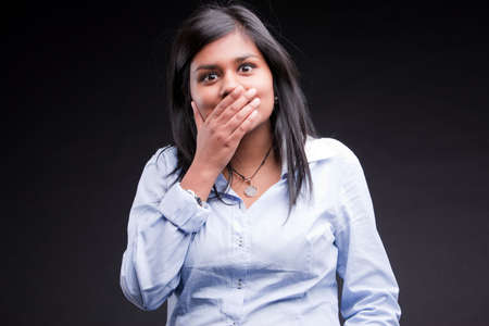 indian girl realizing she mistaken something but maybe she can solve the problem Stock Photo