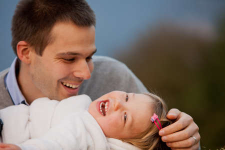 bewitched: happiness is a father bewitched by his little daughters laughter Stock Photo