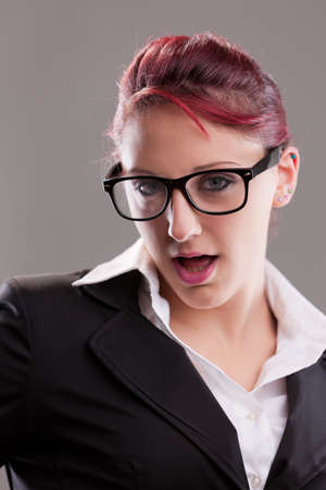 artifice: redhaired sexy eighties secretary with glasses staring at camera with some artifice Stock Photo