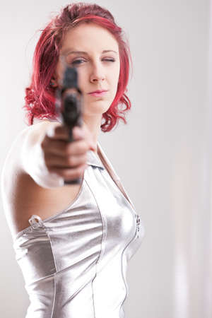 crime fighter: super space vintage heroine with a gun aiming at you Stock Photo