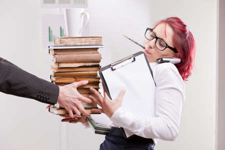indifferent man overloading colleague woman with work