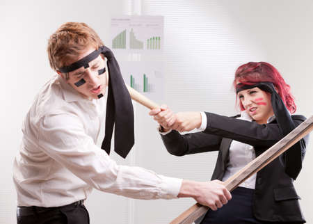 contend: bias gender annoyances at work in the office Stock Photo