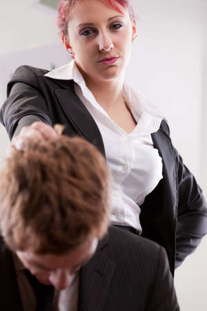 displeased businessman: bias gender annoyances at work in the office Stock Photo