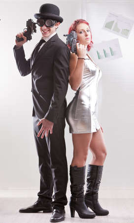 business metaphore: a weird couple of strange business superheroes Stock Photo