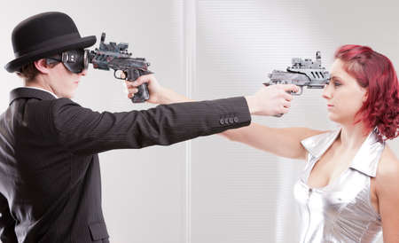 contend: a weird couple of strange business superheroes Stock Photo