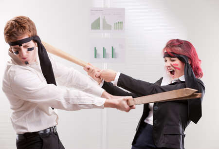 enmity: bias gender annoyances at work in the office Stock Photo