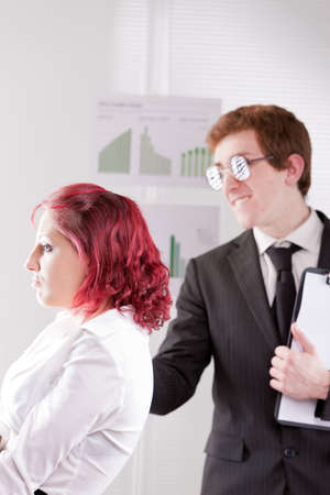 bias: bias gender annoyances at work in the office Stock Photo