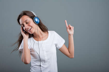 woman with headphones listening to music with pleasure Stock Photo