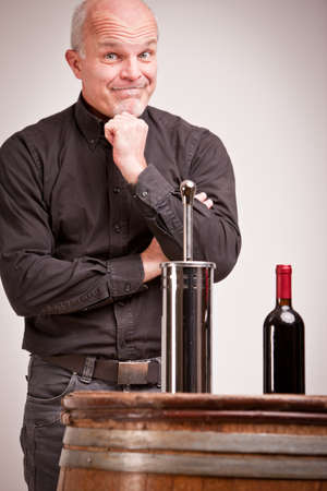 dodgy: toilet brush and red wine bottle compared are not exactly the same so this expert realizes there are quality control problems Stock Photo