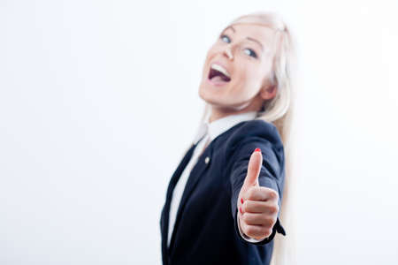 succesful woman: thumbs up succesful woman and smile with a blue jacket Stock Photo