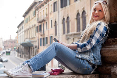 admire: stutent girl spending some time outdoors in an European City as a tourist