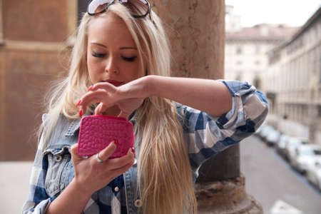 sightsee: blonde tourist girl in Europe spending some money