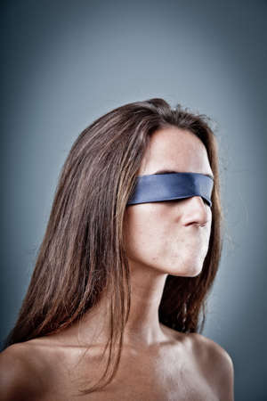 censorship: woman without her mouth representing lack of freedom of speech and that there is heavy censorship Stock Photo