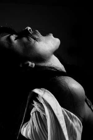 sensation: monochrome portrait of a sexy woman with her mouth open living a good sensation