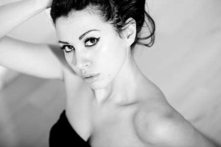 sixties: black and white portrait of a beautiful woman in a fifties or sixties vingate style (like) Stock Photo