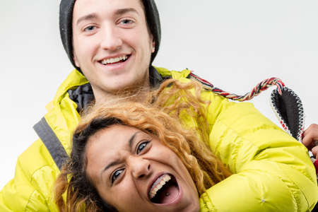 anorak: happy friends black girl and white boy making faces