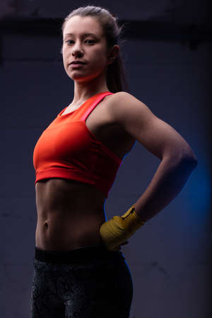 bellybutton: proud and confident boxing woman stands up challenging her next opponent