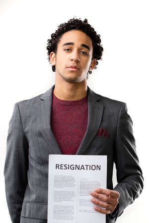 resignation: resignation sheet in young sad mans hand