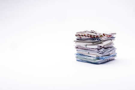 snoot: a stack of folded handkerchiefs on white background