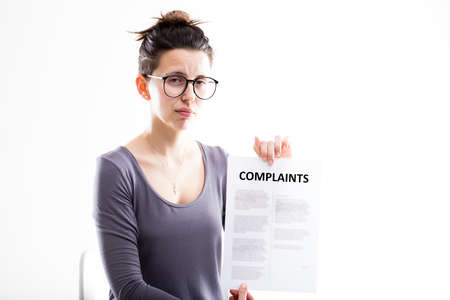 complaints: sad woman showing just received complaints and thinking what to do to solve the problem