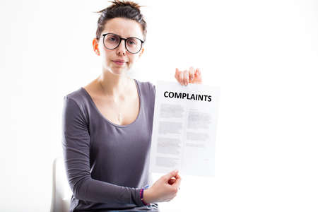 complaints: disappointed woman with glasses sending complaints to you